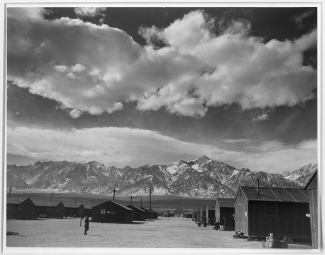 Ansel Adams (American, 1902-1984) 'Manzanar street scene, clouds, Manzanar Relocation Center' 1943