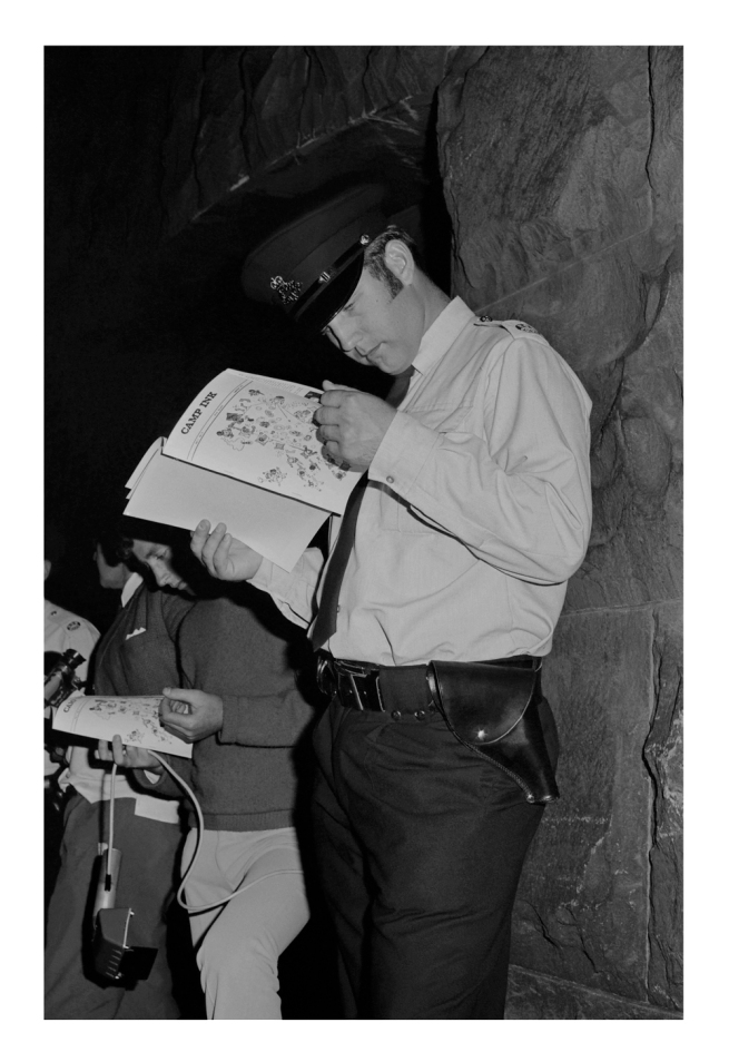 Phillip Potter. 'Policeman reading 'Camp Ink' magazine' 1971