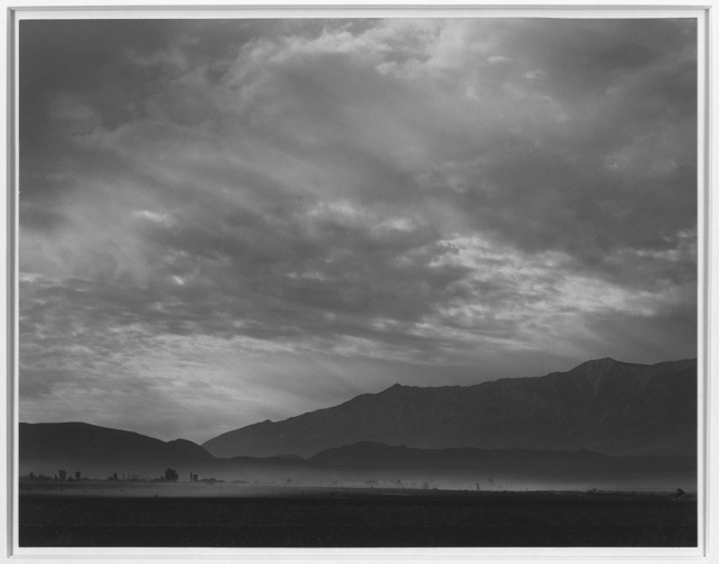 Ansel Adams (American, 1902-1984) 'View SW over Manzanar, dust storm, Manzanar Relocation Center' 1943