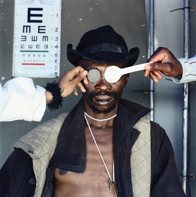 Mikhael Subotzky (1981 Cape Town) 'Joseph Dlamini (Eye test), Matsho Tsmombeni squatter camp' 2012