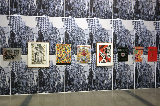 David McDiarmid Installation views of various Sydney party posters with a black and white background wallpaper of David and the HIV Living group's 'Day of the dead skeleton for the Sydney Gay and Lesbian Mardi Gras, 1992'