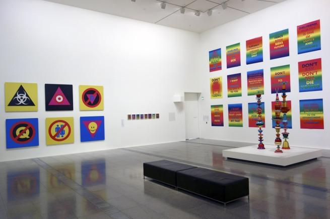 Installation photograph of the last room showing, at right on the wall, work from the 'Rainbow Aphorisms' series 1994 with in front 'Totem works' 1992-95, then at left on the wall 'Pictograms' 1995
