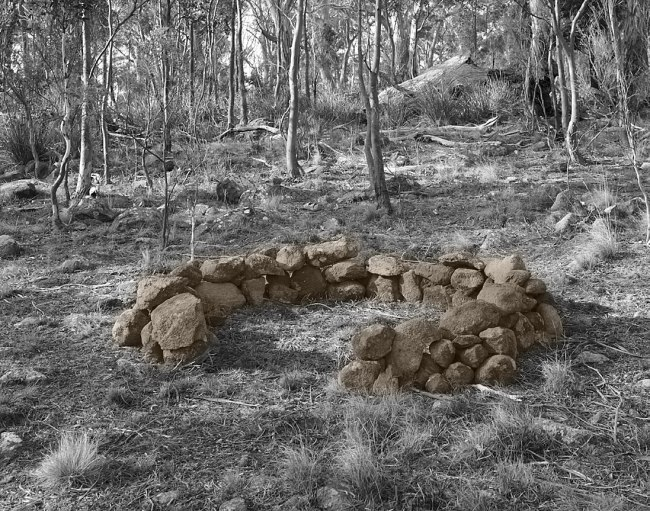 James Tylor. 'Un-resettling (stone footing for dome hut)' 2013
