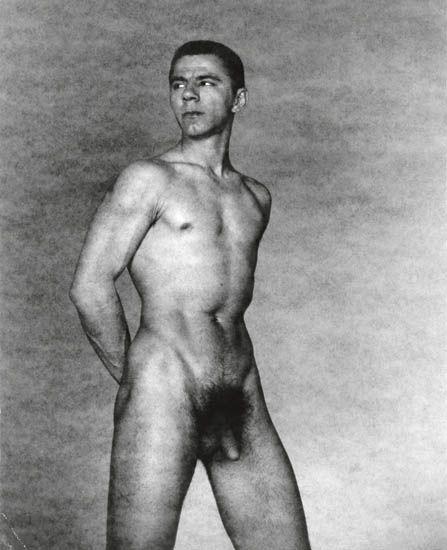 George Platt Lynes. 'Ted Starkowski (standing, arms behind back)' c. 1950