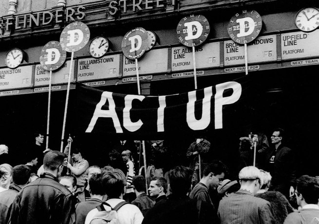 Unknown photographer. 'ACT UP D-Day on the steps of Flinders St. Station, 6 June 1991' 1991