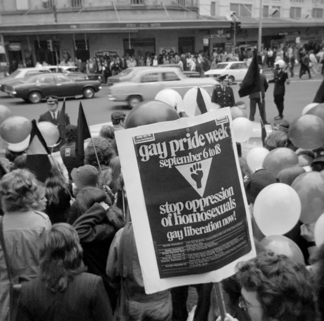 John Englart. 'Gay Pride Week poster, Gay Pride march outside the Town Hall Hotel, Sydney Town Hall' Sydney, 1973