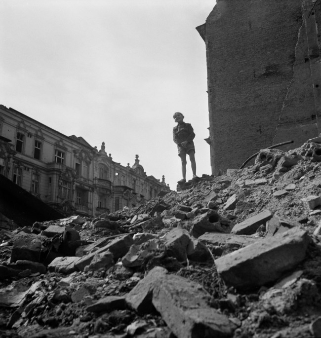 Roman Vishniac. '[Boy standing on a mountain of rubble, Berlin]' 1947