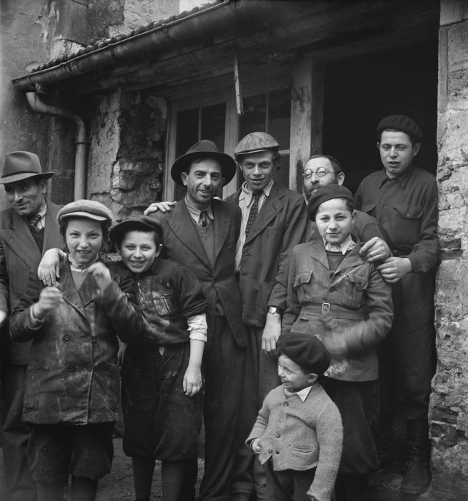 Roman Vishniac. '[Holocaust survivors gathering outside a building where matzoh is being made in preparation for the Passover holiday, Hénonville Displaced Persons' Camp, Picardy, France]' 1947
