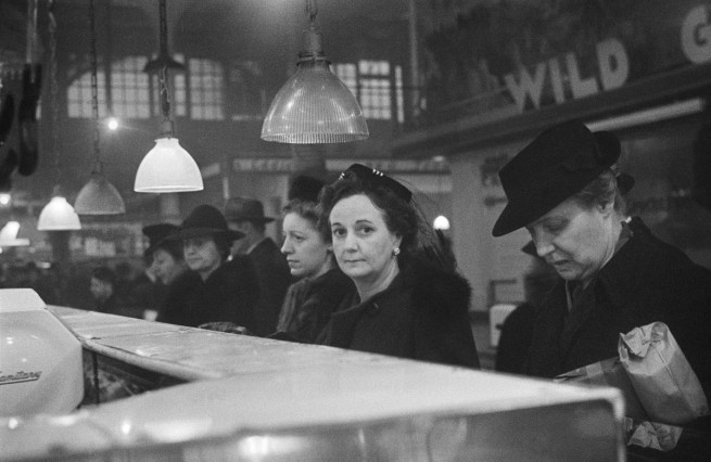 Roman Vishniac. '[Customers waiting in line at a butcher's counter during wartime rationing, Washington Market, New York]' 1941-44