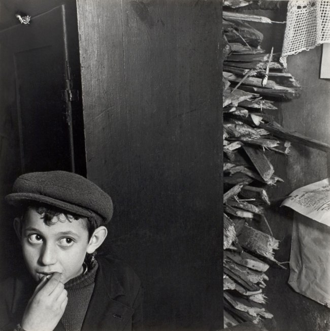 Roman Vishniac. '[Boy with kindling in a basement dwelling, Krochmalna Street, Warsaw]' c. 1935-38