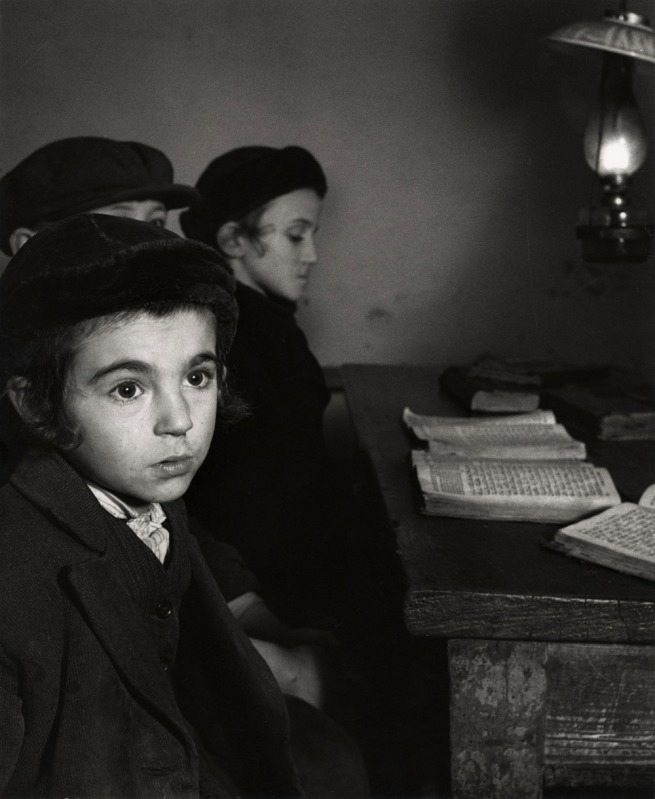 Roman Vishniac (1897-1990) '[David Eckstein, seven years old, and classmates in cheder (Jewish elementary school), Brod]' c. 1938