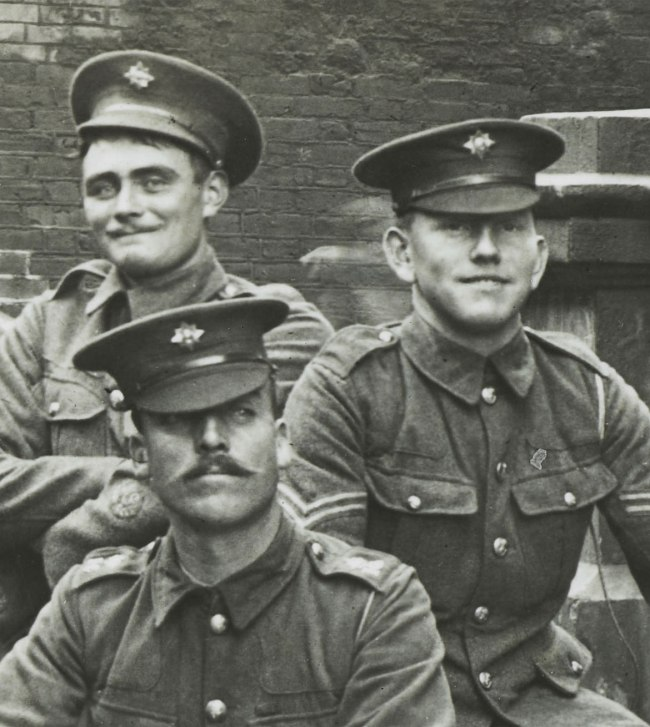 Christina Bloom. 'Captain Greer of the 1st Irish Guards and his machine gun team group together for this rather formal photograph, just prior to leaving for the war' (detail) Nd