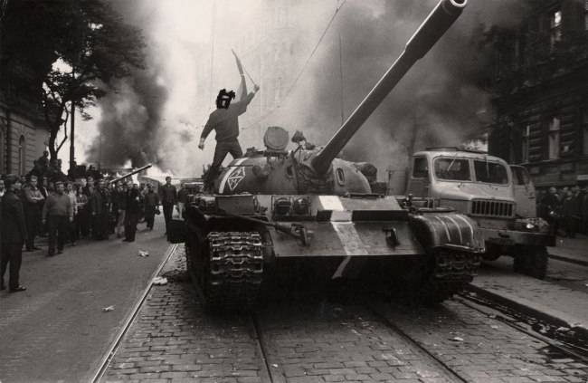 Josef Koudelka. 'Untitled (Student on tank, eyes crossed out)' 1968