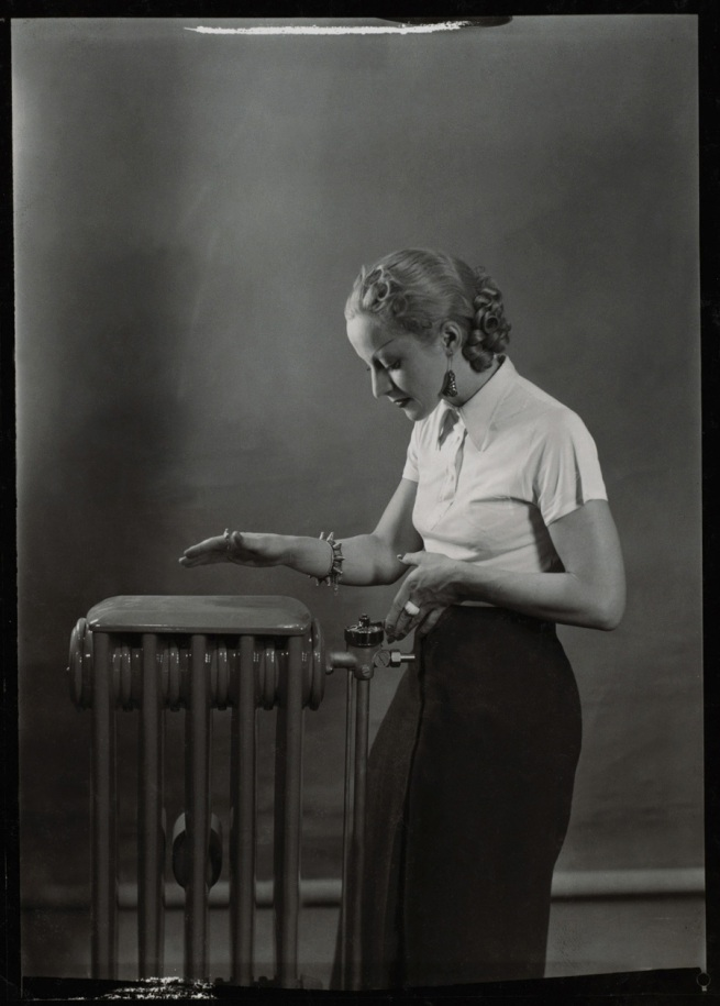 "Éditions Paul Martial, Paris. 'Woman posing next to radiator, advertising photography for ""Gaz et Eaux""' April 1936"