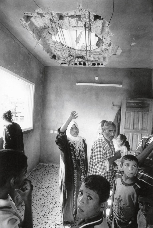 Jean Mohr. 'A needs assessment visit to stricken families, Khan Yunis, Gaza, 2002'