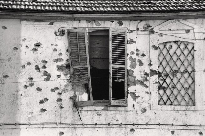Jean Mohr. 'Bullet-holes in a façade, Cyprus, 1974'