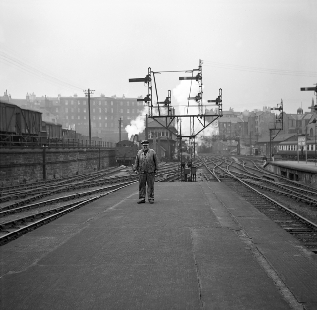 Anonymous photographer. 'Man on platform in front of signal array' mid-1950s to the early 1960s