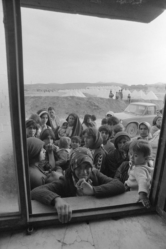 Jean Mohr. 'Kurdish refugees waiting for a food distribution, Qatr camp, Mahabad, Iran, 1991'