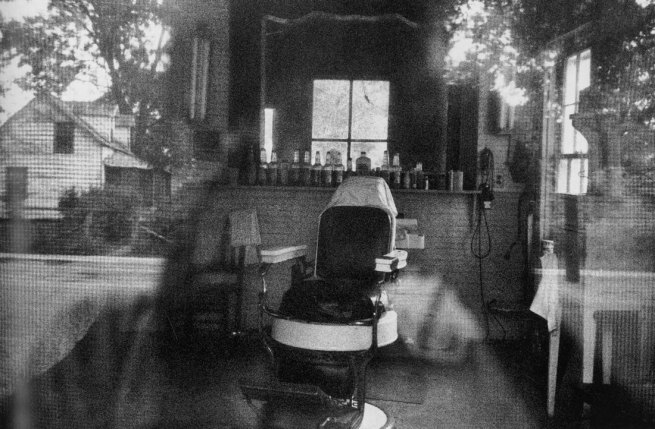 Robert Frank. 'Barber shop through screen door - McClellanville, South Carolina' 1955
