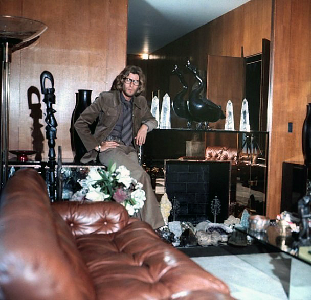 Horst P. Horst. 'Yves Saint Laurent poses in the apartment's grand salon for a November 1971 'Vogue' photo spread' 1971