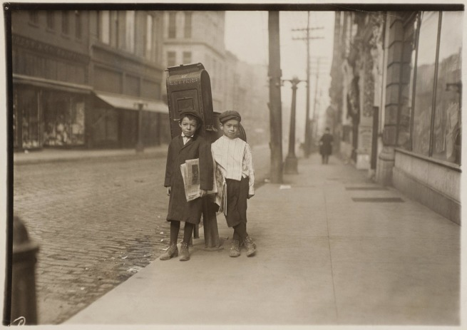 Lewis Wickes Hine. 'Two 7-Year-Old Nashville Newsies, Profane and Smart, Selling Sunday' 1910