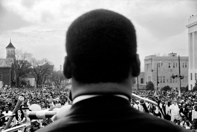 Stephen Somerstein. 'Dr. Martin Luther King, Jr. Looks out at crowd in Montgomery' 1965