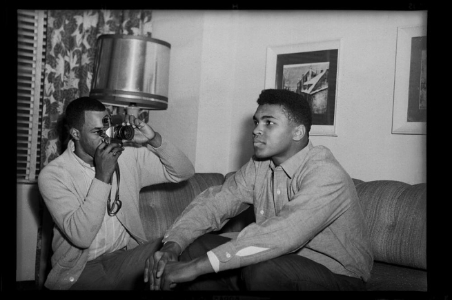 "Charles ""Teenie"" Harris (1908-1998) 'Photographer taking picture of Muhammad Ali (Cassius Clay) possibly in Carlton House Hotel, Downtown' 1963; printed 2001"