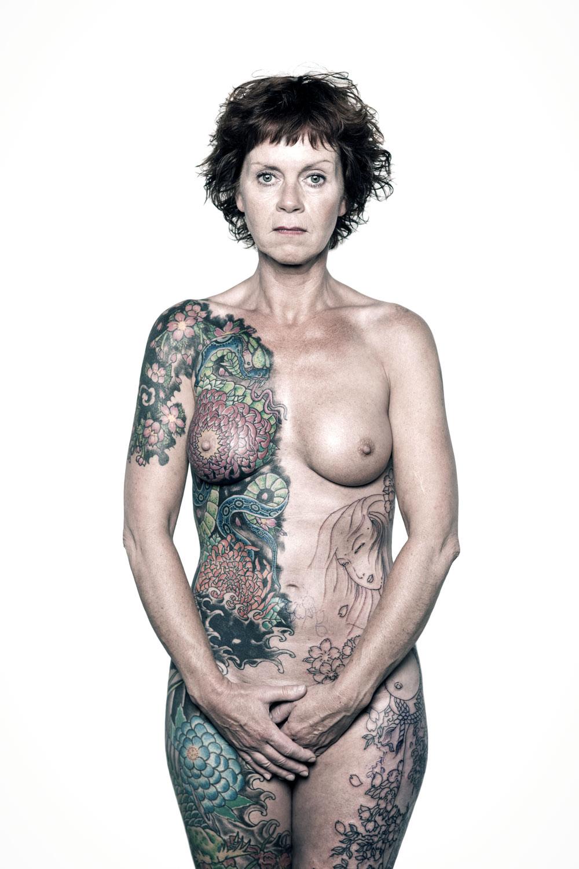Nude genital tattooed woman