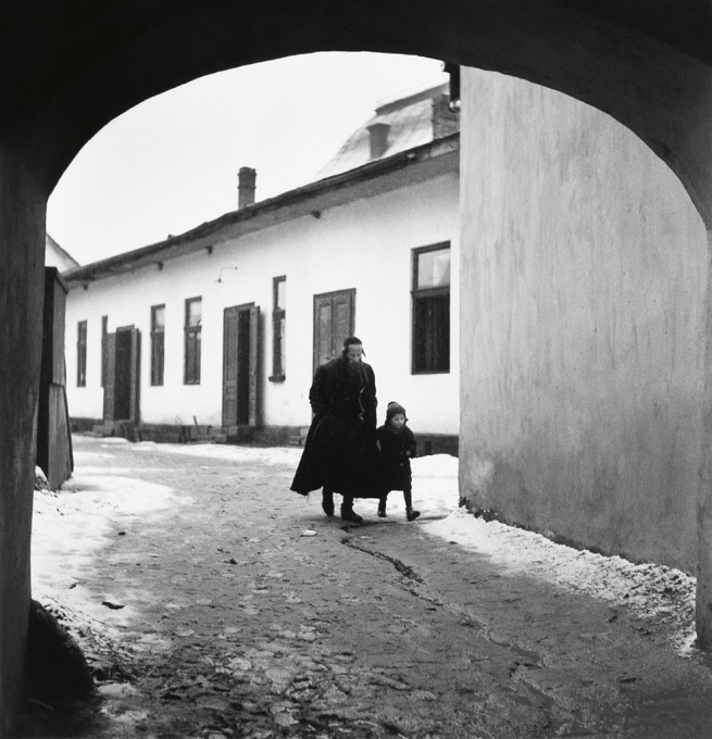 Roman Vishniac (1897-1990) 'Father taking his son to the first day of cheder' 1937-1938