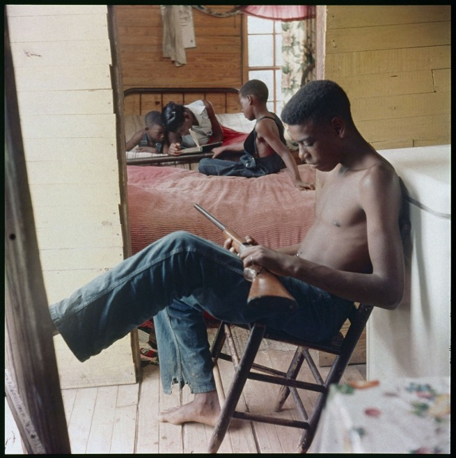 Gordon Parks (American, 1912-2006) 'Willie Causey, Jr., with Gun During Violence in Alabama, Shady Grove, Alabama' 1956