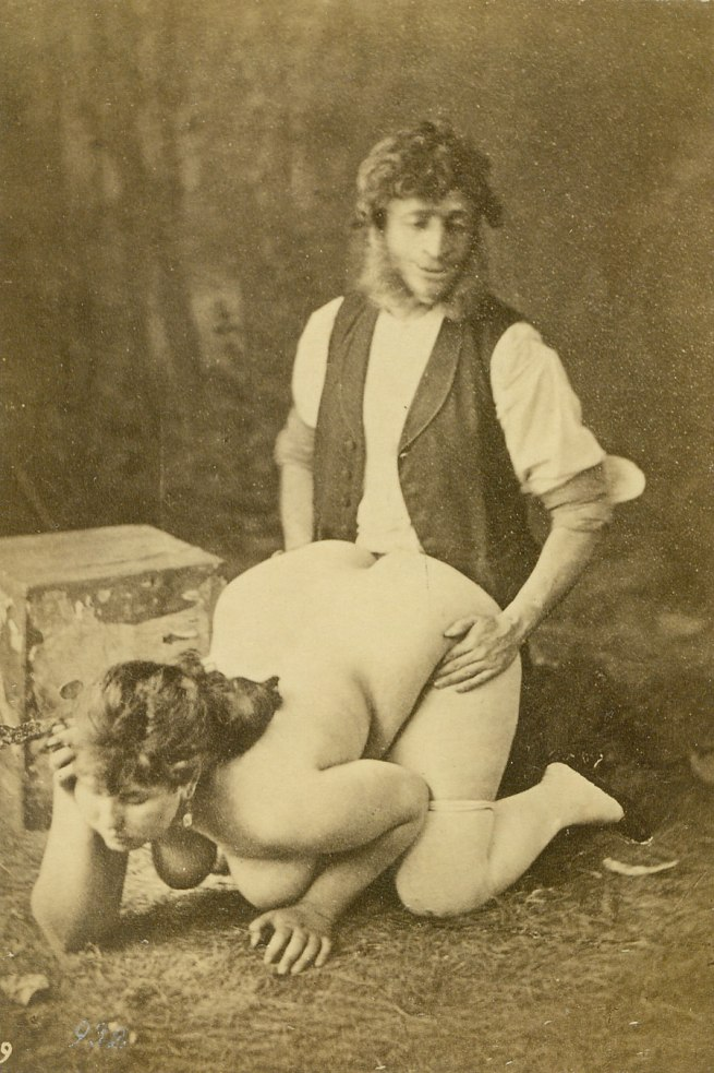 Unknown photographer, France 'Clothed man kneeling behind a nude woman' 1884-1886