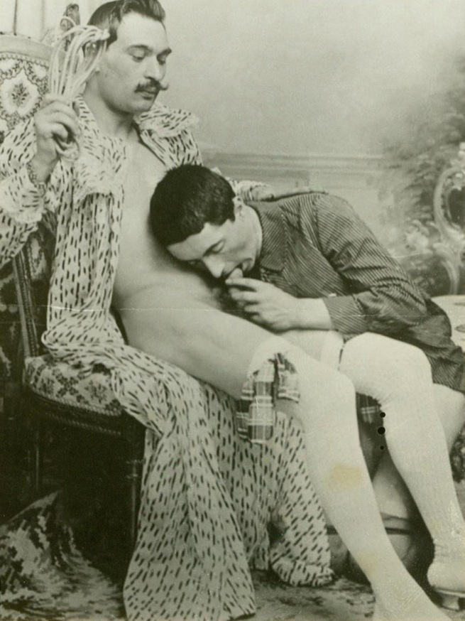 Unknown photographer (France) 'Man in robe receiving oral sex from a kneeling man' c.1890