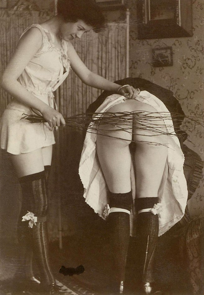 Unknown photographer. 'Woman spanking another woman with birch rod' 1895-1898