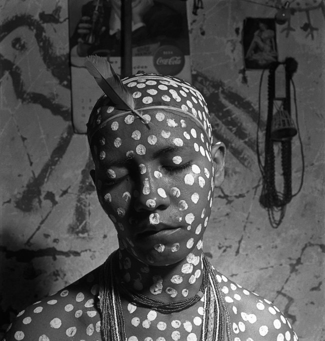 José Medeiros (1921-1990) 'Novice painted with white dots that allude to Oxalá, the god of creation, and with red feathers (ekodidé), the initiation ritual, Salvador' 1951