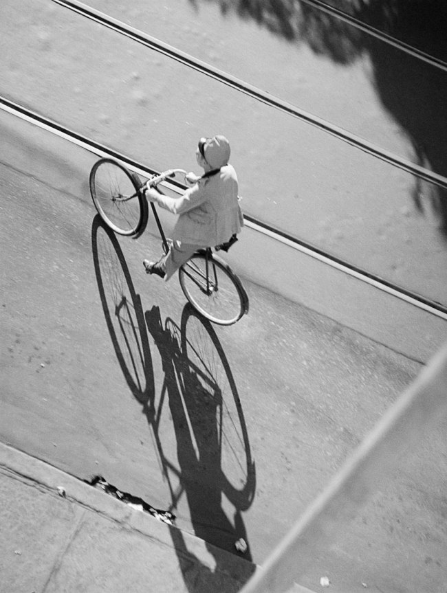 José Medeiros (1921-1990) 'Woman on a bicycle crossing the railroad tracks, Rio de Janeiro' 1942
