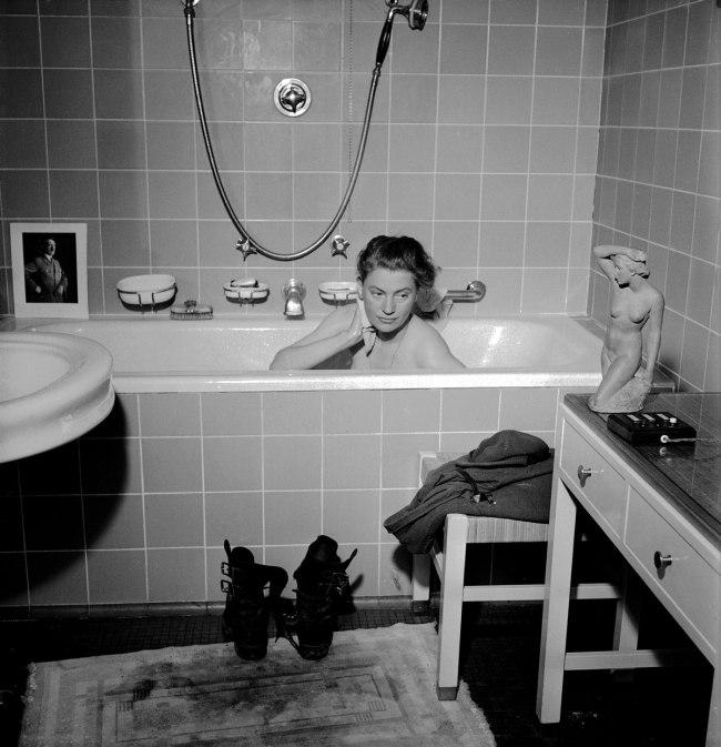 Lee Miller with David E. Scherman. 'Lee Miller in Hitler's Bathtub, Munich, Germany' 1945