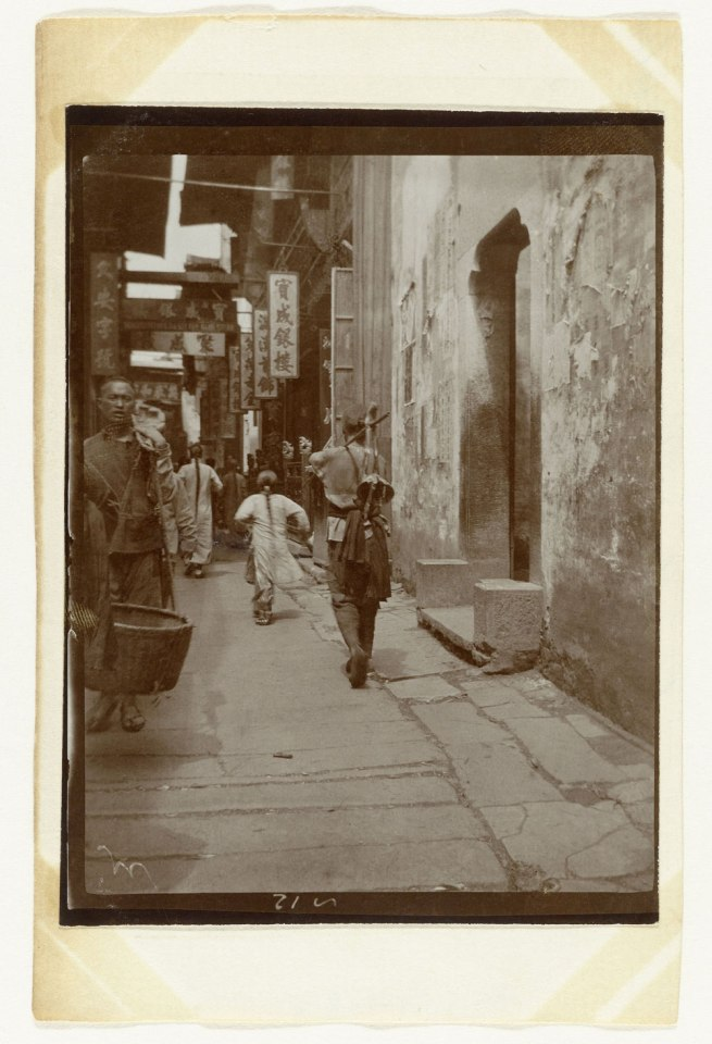 Attributed to Jan Adriani. 'A street with several people in Kinkiang, China' 1907