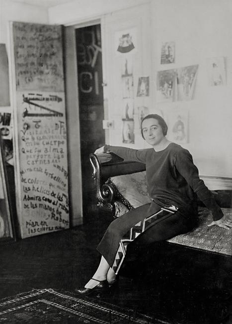 'Sonia Delaunay in front of her door-poem in the Delaunays' apartment, Boulevard Malesherbes, Paris' 1924