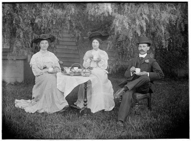 Michael J Drew (1873-1943) 'Group taking tea in a garden' between 1890 and 1900