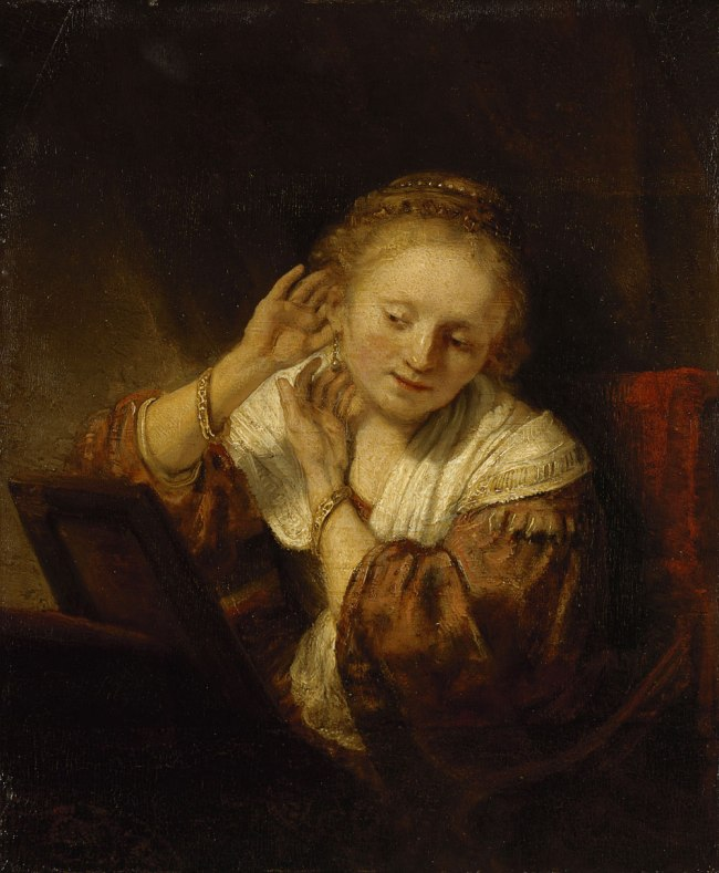 Rembrandt Harmensz. van Rijn (Dutch 1606–69) 'Young woman trying on earrings' 1657