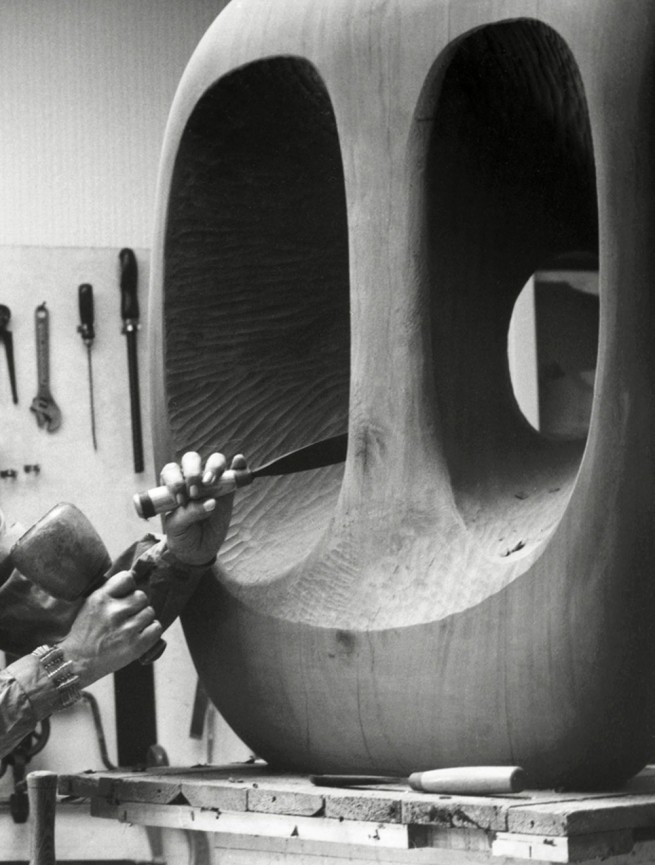 Val Wilmer. 'Barbara Hepworth in the Palais de la Danse studio, St Ives, at work on the wood carving Hollow Form with White Interior' 1963 (detail)