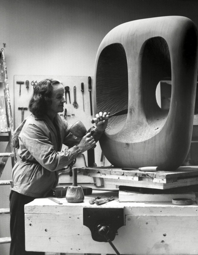 Val Wilmer. 'Barbara Hepworth in the Palais de la Danse studio, St Ives, at work on the wood carving Hollow Form with White Interior' 1963