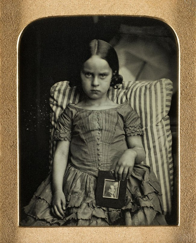 Ross and Thomson of Edinburgh. 'Unknown little girl sitting on a striped cushion holding a framed portrait of a man, possibly her dead father' 1847-60