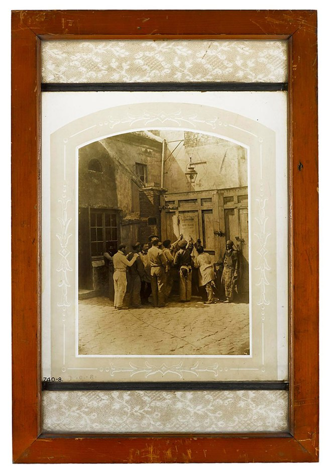 Photograph burnt in on glass, a group of workmen, Paris 1858