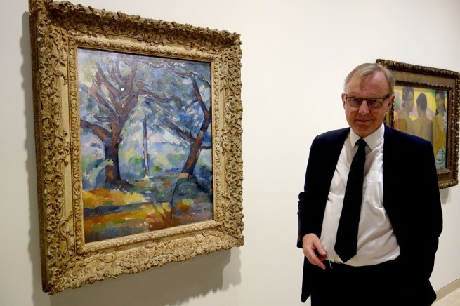 Michael Clarke, Director of the National Galleries of Scotland, with Paul Cézanne's 'The big trees' c. 1904