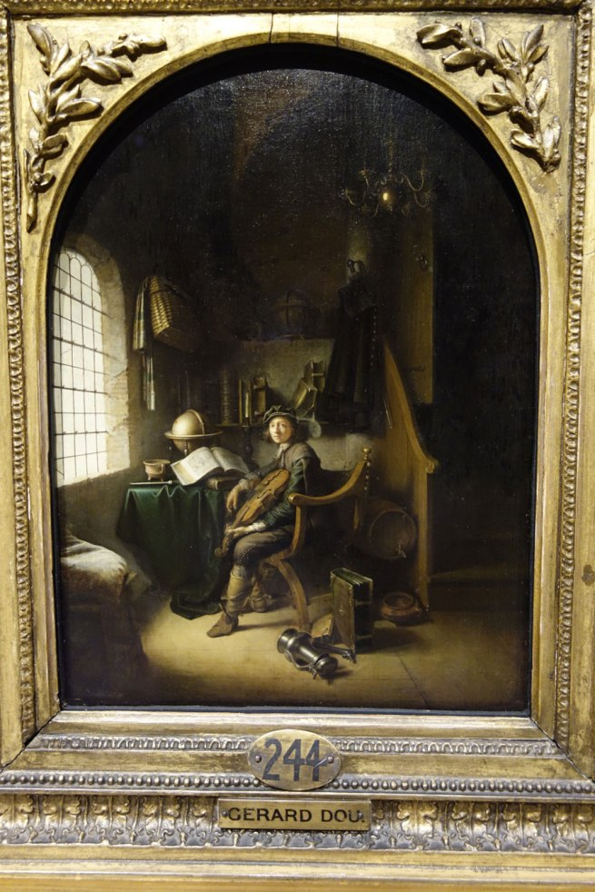 Gerrit Dou (The Netherlands, 1613-75) 'An interior with a young viola player' 1637