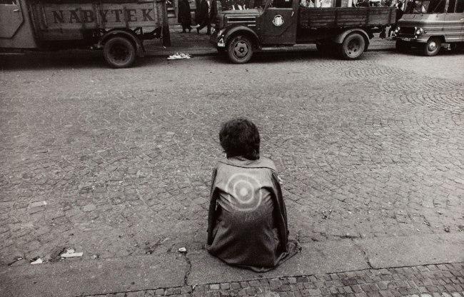 Josef Koudelka. '(Czech citizen on sidewalk, wearing jacket with target)' 1968