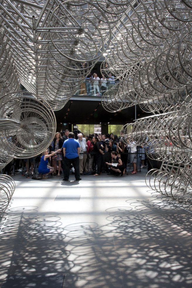 Ai Weiwei talking to the media in front of his installation 'Forever Bicycles' (2015)