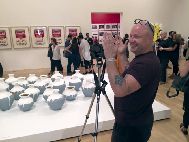 Marcus photographing the the exhibition 'Andy Warhol | Ai Weiwei' at the National Gallery of Victoria