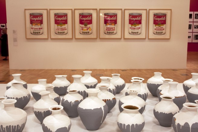 Installation view of the first room including Andy Warhol's screen prints from his 'Campbell's Soup II' series (1969), with Ai Weiwei's 'Coloured Vases' (2015, detail)